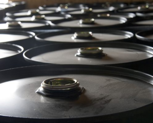 Rows of oil drums in the storage facility